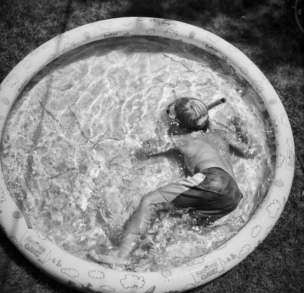 Boy in backyard pool